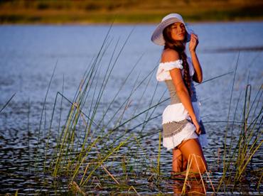 Sexy model posing in lake water in sunshine